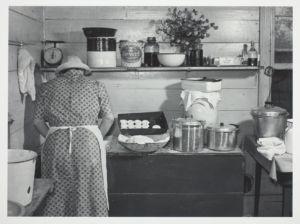 Woman in kitchen.
